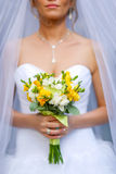 Close-up of bride hands holding beautiful wedding bouquet Stock Photography