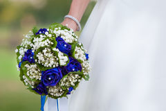 Bride bouquet. Close-up of bride holding blue roses bouquet Royalty Free Stock Image