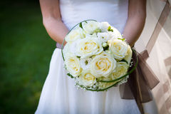 Bride bouquet. Close-up of bride holding white roses bouquet Stock Photography
