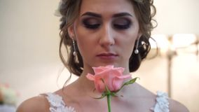 Close-up of a bride with a rose in hand stock video footage