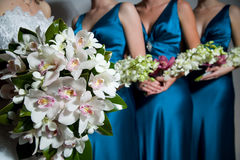 Close up of Bride's bouquet, bridesmaids behind Stock Images