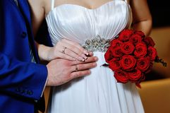 Close-up of bride's and groom's hands showing wedding rings Stock Photo