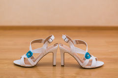 Close up of bride's shoes and gold wedding rings Stock Photography