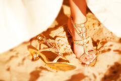 A close up of a bride's wedding shoes Stock Images