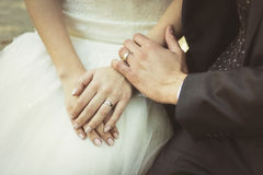 Close-up of bridegroom wearing wedding ring on bride's finger Royalty Free Stock Images