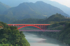 Colorful bridges in Taoyuan Taiwan. Pink and red bridges in Taoyuan Taiwan in the late afternoon against a mountain background Stock Photography