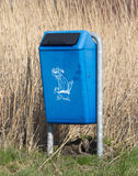 Close up of bright blue dog mess poop bin. With Label royalty free stock photo