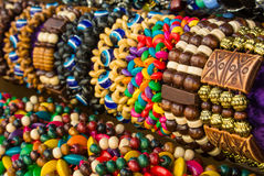 Close up of bright colorful wooden braided bracelets with beads at the street market Stock Photography
