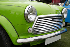 Close up of a bright green car. Close up of the front of a bright green classi English car at an outdoor car display Royalty Free Stock Photography