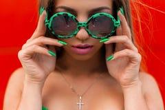 Close-up bright portrait of a beautiful stylish woman royalty free stock photos