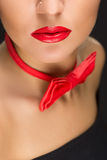 Close-up of bright red lips, tied around his neck. Close-up of bright red sexy lips, tied around his neck the bow tie Royalty Free Stock Image