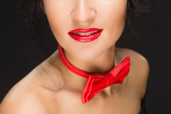 Close-up of bright red lips, tied around his neck Royalty Free Stock Image