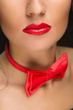 Close-up of bright red lips, tied around his neck Stock Photos