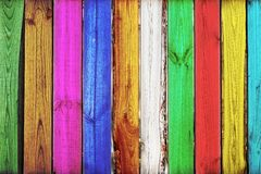 Close-up of bright vertical colorful oak wooden fence background. Creative art backdrop.Vintage rustic multicolored pattern. Copys. Pace Royalty Free Stock Photos