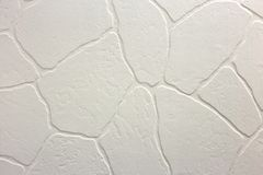 Close-up of bright white plastered uneven stucco wall. Abstract texture, chaotic copy space background. Decorative grunge space.  stock photography