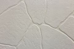 Close-up of bright white plastered uneven stucco wall. Abstract texture, chaotic copy space background. Decorative grunge space.  royalty free stock images