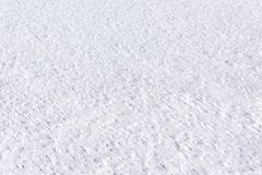Bright snow texture or background in perspective. Close-up of bright white snow texture or background, surface of the snow in perspective Stock Photos