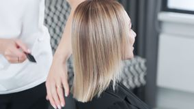 Close up brilliant and silky hair after treatment, care procedures, slow motion