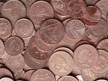 Closeup British copper coins pennies pence. A close-up of British one and two pence pieces - shiny copper stock photo
