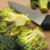 Close up of broccoli florets on wooden table Stock Photography