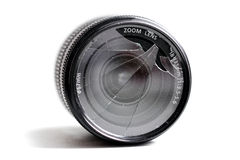 Close up of a broken camera lens, on a white. Royalty Free Stock Photos
