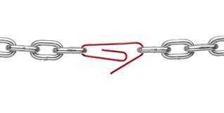 Broken metal chain. Close up of a broken chain and a paper clip on white background Stock Photo