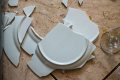 Close up on broken dishes on the floor Royalty Free Stock Images