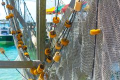 Close up of Broken Fishing Nets in a Sunny Day. On Blur Background. Destin Marina, Florida royalty free stock photo