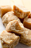 Close Up of Broken Fudge Pieces on Parchment Paper Royalty Free Stock Photo