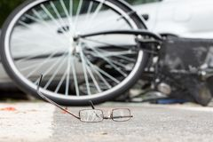Close-up of broken glasses after collision with a biker and irresponsible car driver. Close-up of broken glasses after collision of a biker and irresponsible car royalty free stock images
