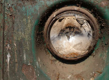 Close up of broken headlight on old vintage moldy bus in Asia. Broken headlight of old vintage bus in Yangon (Rangoon), Myanmar (Burma).  Mold, fungus, and Royalty Free Stock Photos