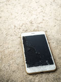 Close up of broken mobile phone drop. On cement floor with copy space, High Contrast, Shallow Depth of Field stock photos