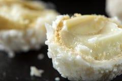 Close up of broken Raffaello white candy with coconut flakes Stock Photos