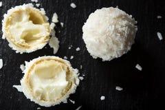 Close up of broken Raffaello white candy with white cream Royalty Free Stock Photos
