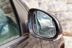 Broken Rearview Mirror. Close-up of a broken rearview mirror in a modern black car Royalty Free Stock Photos