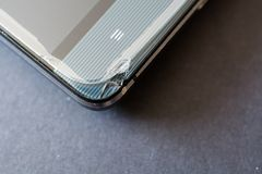 Close up of broken smart phone. Crashed glass of a phone display stock photo