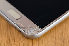 Detail of broken smart phone. Close up of broken smart phones glass stock images