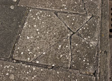 Broken paving slab Stock Photos