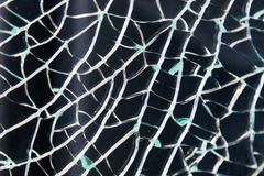 Close-up on broken tempered glass with texture. Close-up on broken window tempered glass with texture Royalty Free Stock Image