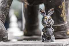 Close up of bronze metal rabbit bunny decoration in a temple in Hat Yai Thailand royalty free stock photo