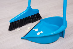 Close up of broom and dustpan with paper trash Royalty Free Stock Images