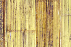 Close up brown bamboo fence background processed in vintage style Royalty Free Stock Photos