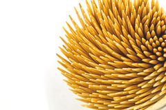 Close up brown bamboo toothpicks on white background on top view Stock Images