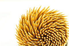 Close up brown bamboo toothpicks on white background Stock Photos