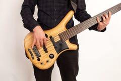 Close up of a brown bass guitar with hands Stock Photos