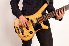 Close up of a brown bass guitar with hands Stock Photo