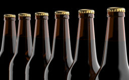 Close up brown beer bottles. Studio 3D render, on black background. Royalty Free Stock Photo
