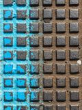 Close - up of a brown and blue manhole cover stock image