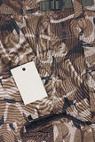 Close-up brown camoflage pocket shorts with tag (s Stock Photos