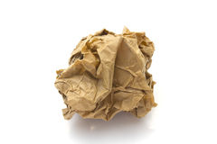 Close-up of brown crumpled paper ball. Stock Photo Royalty Free Stock Photos